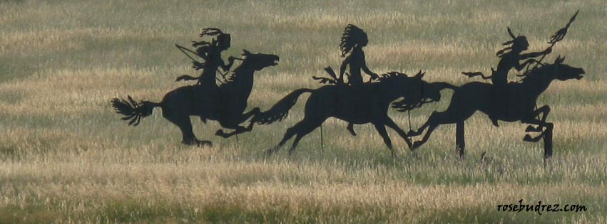 iron cut out of 3 indians on horseback.